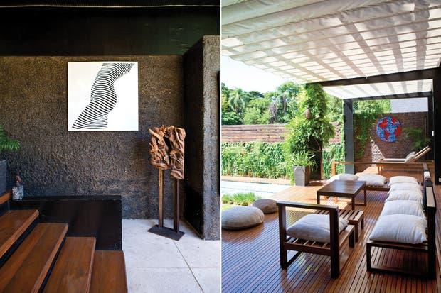 """El cuadro a la izquierda, """"Mujer con códigos"""", pertenece a la misma serie que el que está junto a la chimenea.."""