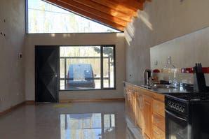Caso 394: ¿cómo decorarías el living con cocina integrada de esta casa?