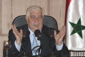 Walid al Mualem, ministro sirio de Exteriores, desafió a las potencias extranjeras que amenazan atacar a Siria