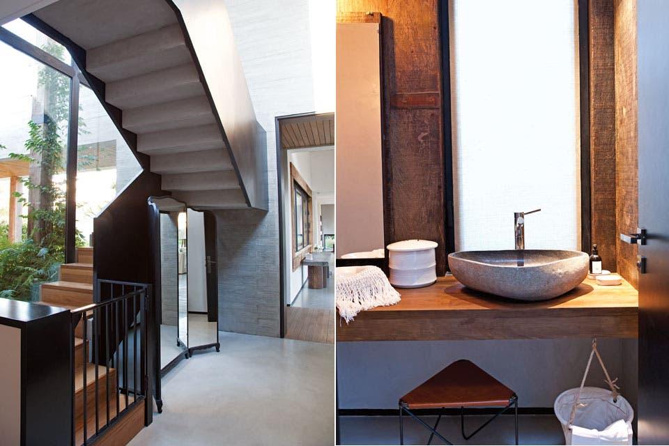 En el toilette, revestimiento y mesada de madera, con una protagónica bacha de piedra, un feliz hallazgo de Karina. La escalera, liviana, se trazó de modo de no interrumpir el paso de luz desde el exterior.  Foto:Living /Magalí Saberian