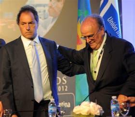 Scioli y Mendiguren, ayer, en la Asamblea Anual de la UIA