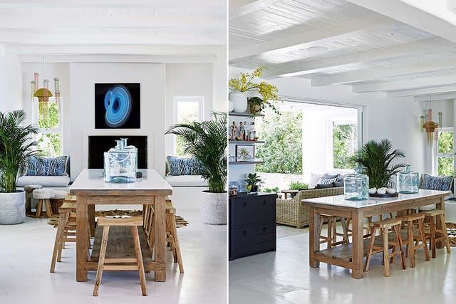 El piso blanco de cemento alisado contrarresta el peso del juego de mesa y bancos de madera