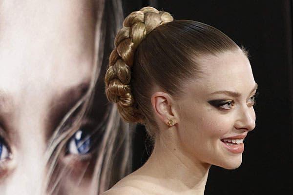 Un estilo fresco pero más jugado, con un recogido con trenza, como lo lució la actriz Amanda Seyfried. Foto: Reuters