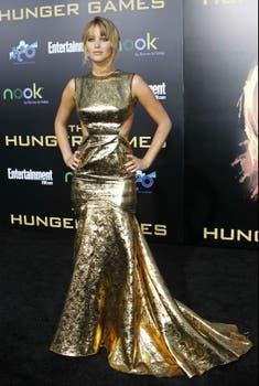 En Los Angeles, Jennifer Lawrence posó para los fotógrafos  en la premiere de The Hunger Games. ¿Qué opinan del look? ¿Aprobada?. Foto: Reuters