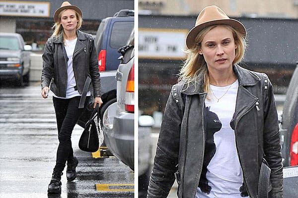 Diane Kruger, con un look para un día lluvioso: pantalón chupín, remera estampada y chaqueta. ¿Qué tal el sombrero?. Foto: Celebritieswonder.net