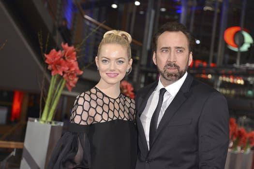 Emma Stone muy bien acompañada de Nicolas Cage, en la presentación de la película animada que protagonizan, en Berlín / EFE.