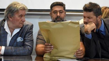 Armando Pérez, Daniel Angelici y Marcelo Tinelli durante la apertura de sobres el lunes pasado