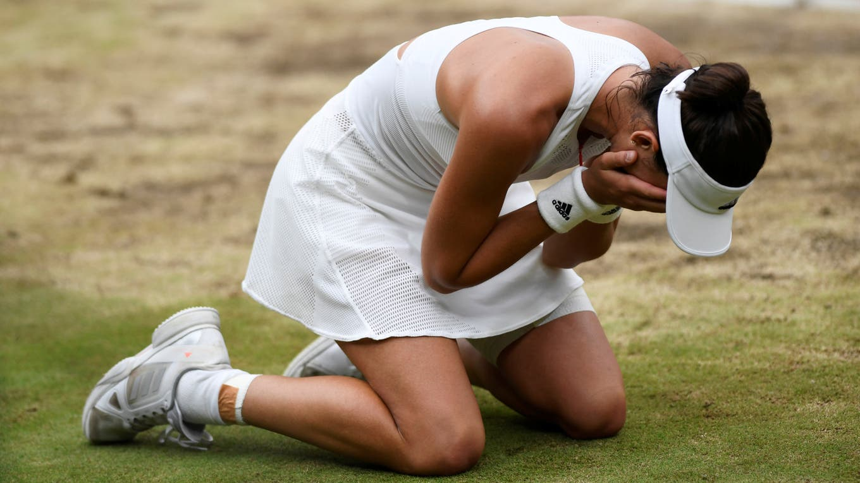 Muguruza festeja el título en Wimbledon foto: Reuters TONY O''''BRIEN