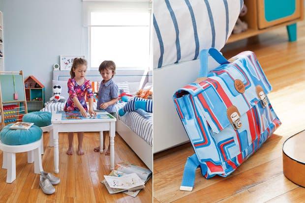 Juana y Luca juegan con un muñeco a rayas ($360). Sobre la cama, muñecos 'Tigre' ($235) y 'Robot' ($275, todo de Sopa de Príncipe).  /Magalí Saberian