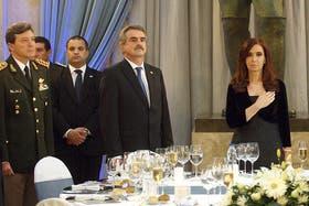 César Milani junto a Agustín Rossi y la presidenta, Cristina Kirchner, durante la cena de camaradería el pasado 10 julio