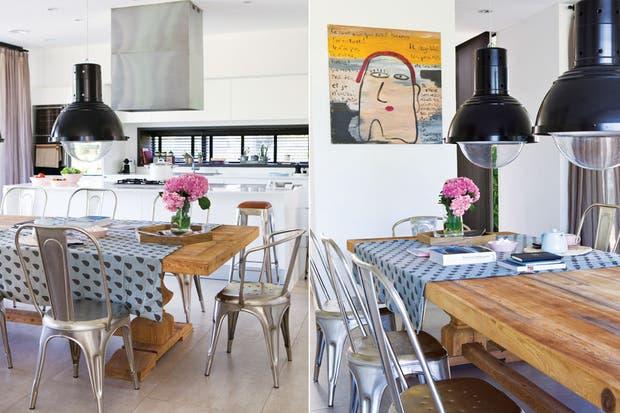 Una gran mesa de madera se conjuga con sillas Tolic en color plata. Las grandes lámparas galponeras le dan el carácter descontracturado al ambiente.  Foto:Living /Archivo LIVING