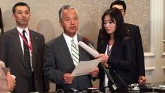 El ministro de Comercio japonés, durante la jornada