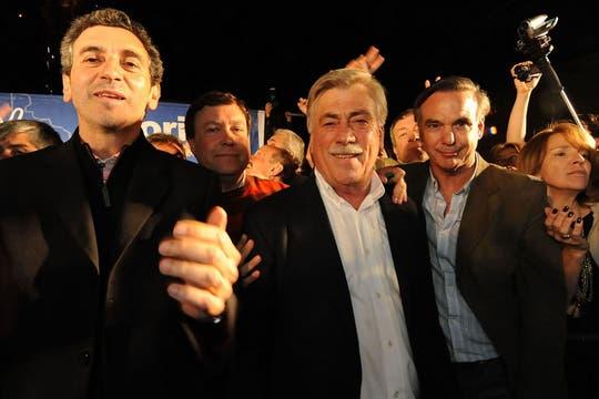 El gobernador de Río Negro, Carlos Soria, junto con el ministro del Interior, Florencio Randazzo, y el senador nacional Miguel Pichetto. Foto: DyN