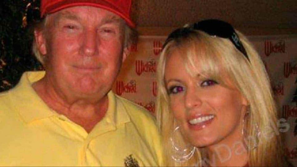 Trump junto a la actriz porno Stephanie Clifford