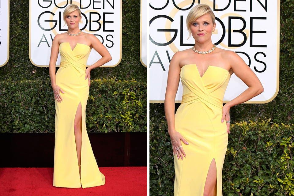 Reese Whiterspoon con un vestido en color amarillo de Nina Ricci y una gargantilla que iba perfectamente con el look elegido. Foto: OHLALÁ! /Reuters, AFP