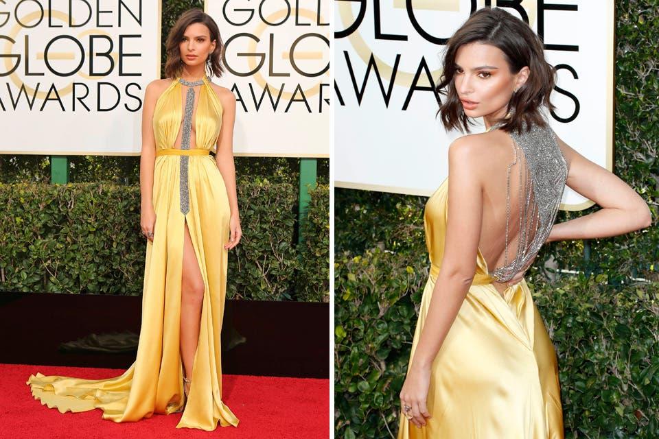 Emily Ratajkowski, una de las más sexies de la noche, llegó vestida por Reem Acra. La modelo eligió un diseño en seda, con escotes varios en color amarillo. Foto: OHLALÁ! /Reuters, AFP