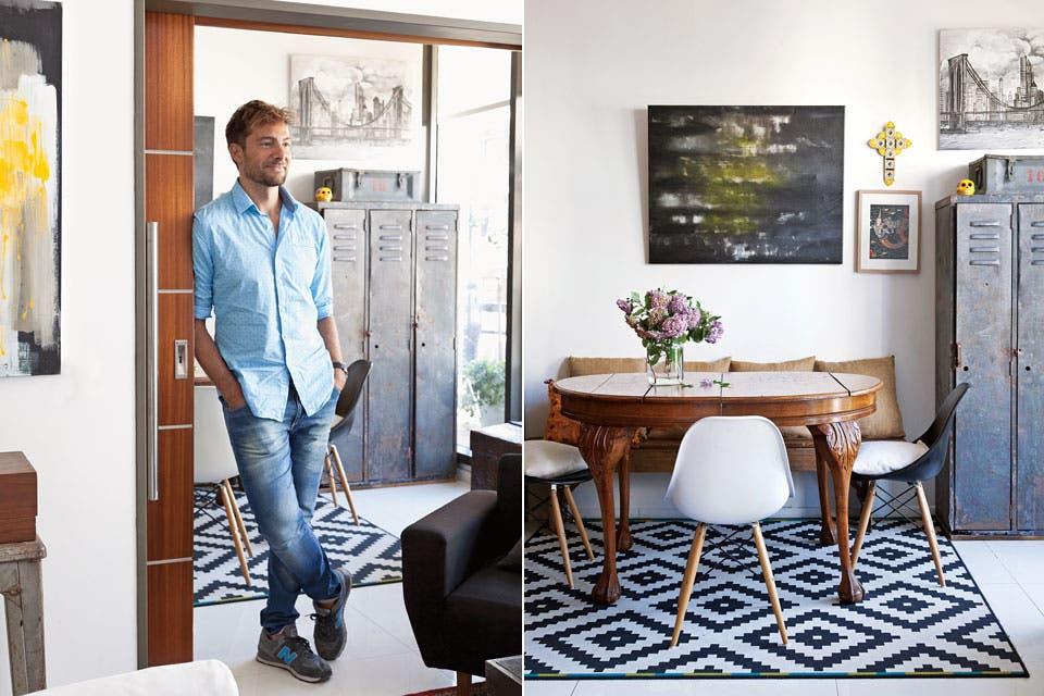 Sobre la alfombra geométrica de Ikea, la mesa de patas torneadas que el dueño canjeó por una de campo que tenía, pero que no pasaba por la puerta del departamento. Sillas 'DSW' de acrílico y un banco rústico con almohadones de arpillera. La pintura es de su autoría.  Foto:Living /Magalí Saberian