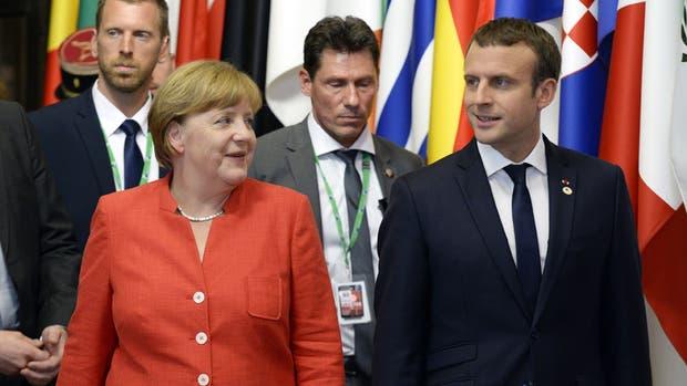 Merkel y Macron, ayer, tras la conferencia de prensa en Bruselas