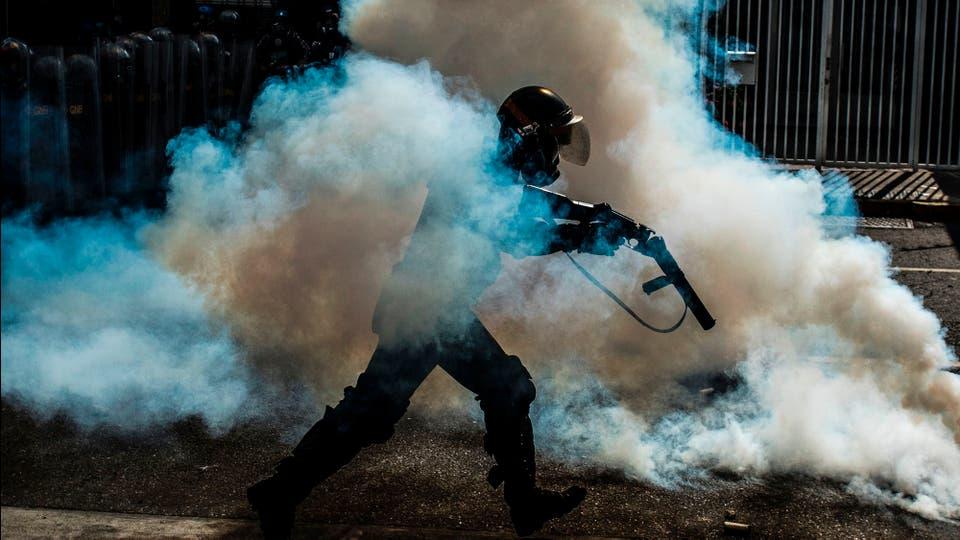Hubo represión policial, con gases lacrimógenos . Foto: AFP / Carlos Becerra
