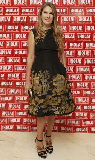 Ana Rusconi eligió un vestido de Oscar de la Renta, con el ruedo bordado con hilos dorados.. Foto: Fabián Marelli