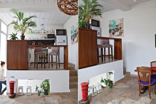 """Después: """"La cocina está integrada, pero no del todo: es cierto que se comunica con el comedor, pero también funciona como un ambiente aparte gracias a los escalones.."""