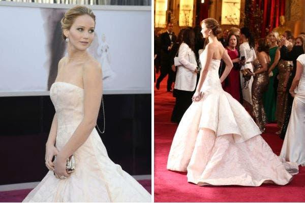 Si de vestidos de cola se trata, el diseño de Dior Haute Couture que eligió Jennifer Lawrence -nominada por el Lado luminoso de la vida, fue otro modelo que se llevó todas las miradas. Ideal para destacar su cintura. Foto: AFP