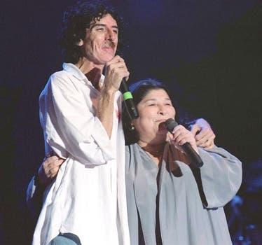 En un recital, junto a Charly García, en el 97. Foto: Archivo / Búsqueda documental de PCDRB