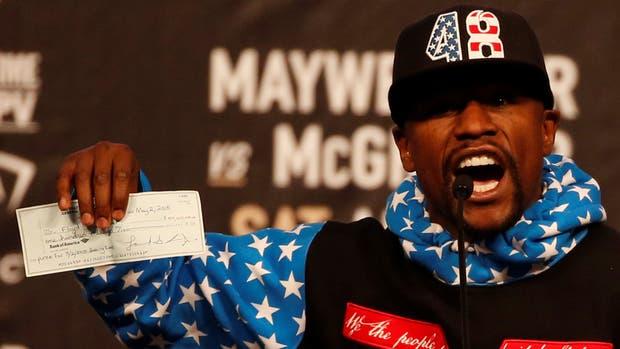 Mayweather y su cheque de 100 millones de dólares