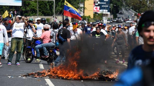 Un choque entre la policía y la oposición en Caracas. Foto: AFP / Juan Barreto