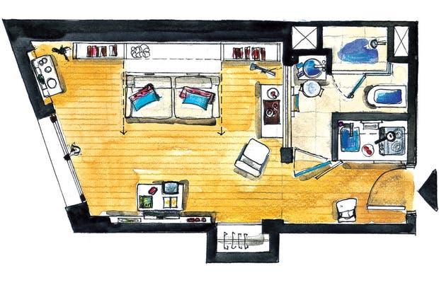 El ambiente principal es mínimo, pero gracias al equipamiento cumple perfectamente dos funciones bien diferenciadas: de día, living y lugar de trabajo; por la noche, dormitorio.