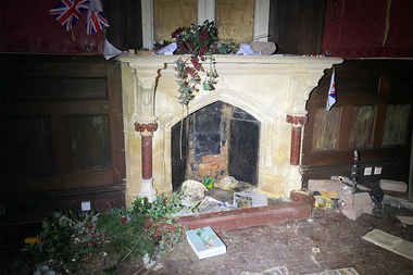 Flags of Great Britain, an abandoned home and books scattered on the ground