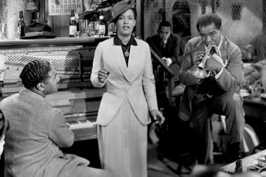 Billie Holliday, con Louis Amstrong