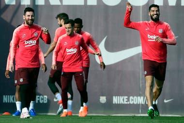 Distensión: Messi y Suárez, en el último entrenamiento antes de Barcelona-Liverpool.