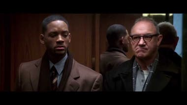 Will Smith y Gen Hackman en Enemigo público