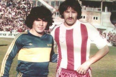 Luque y Maradona, en un duelo entre Unión y Boca.